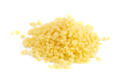 A Pile of Natural Yellow Beeswax Pearls on a Wax Background